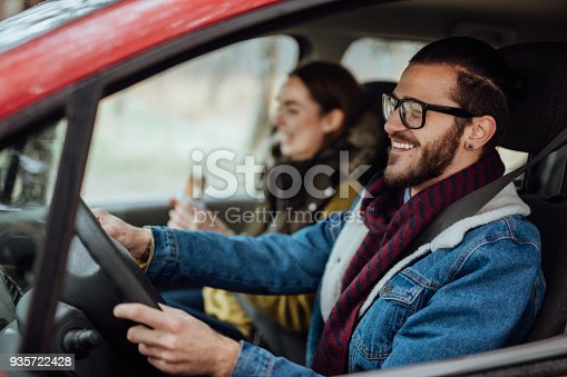 istock Happy young couple traveling by car 935722428