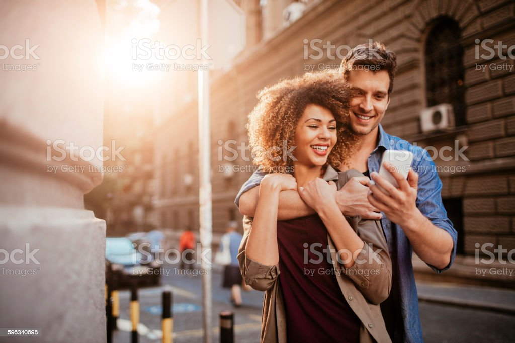 Happy young couple using a phone royalty-free stock photo