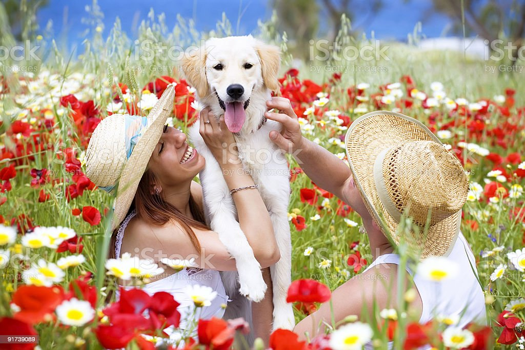 Happy young couple with a dog royalty-free stock photo