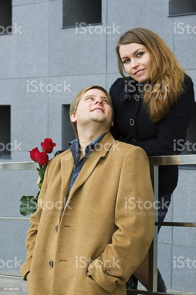 Happy young couple with a roses royalty-free stock photo