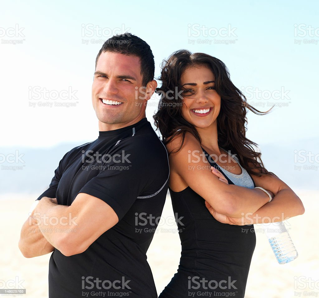 Happy young couple with arms crossed royalty-free stock photo