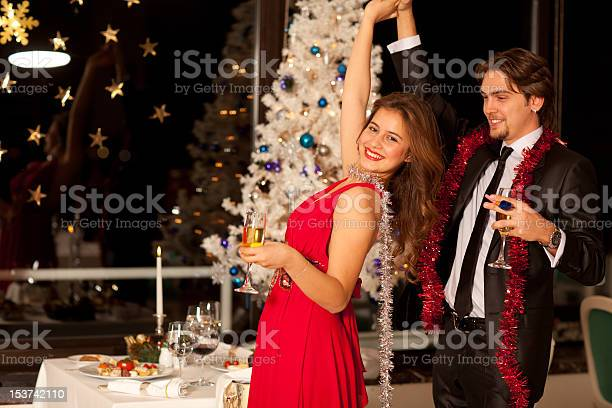 Happy young couple with champagne glasses dancing at christmas picture id153742110?b=1&k=6&m=153742110&s=612x612&h=i6l n6avvaxsqy3moxsssmaulk95tgvhegqfpuebk8k=