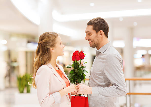Happy young couple with flowers in mall picture id466468976?b=1&k=6&m=466468976&s=612x612&w=0&h=7hdssor6mrn1lx0iv9mwqa3ce yzvt2mzg2t cmhsx8=