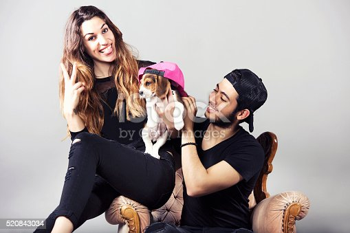 Happy young couple with puppy