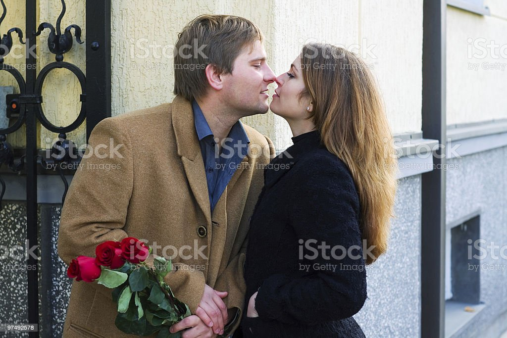Happy young couple with roses royalty-free stock photo