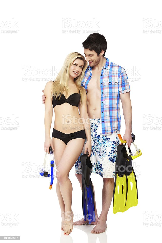 Happy young couple with snorkeling gear over white background royalty-free stock photo