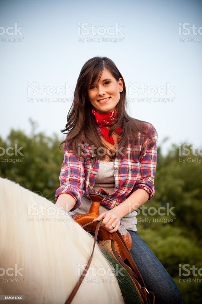 Happy, Young Cowgirl Riding White Horse Outside royalty-free stock photo