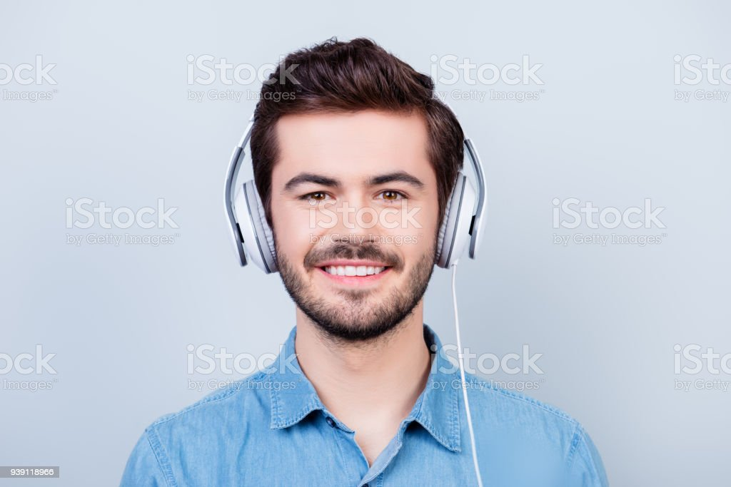 Happy Young Cute Guy Is Listening To The Music In Big White