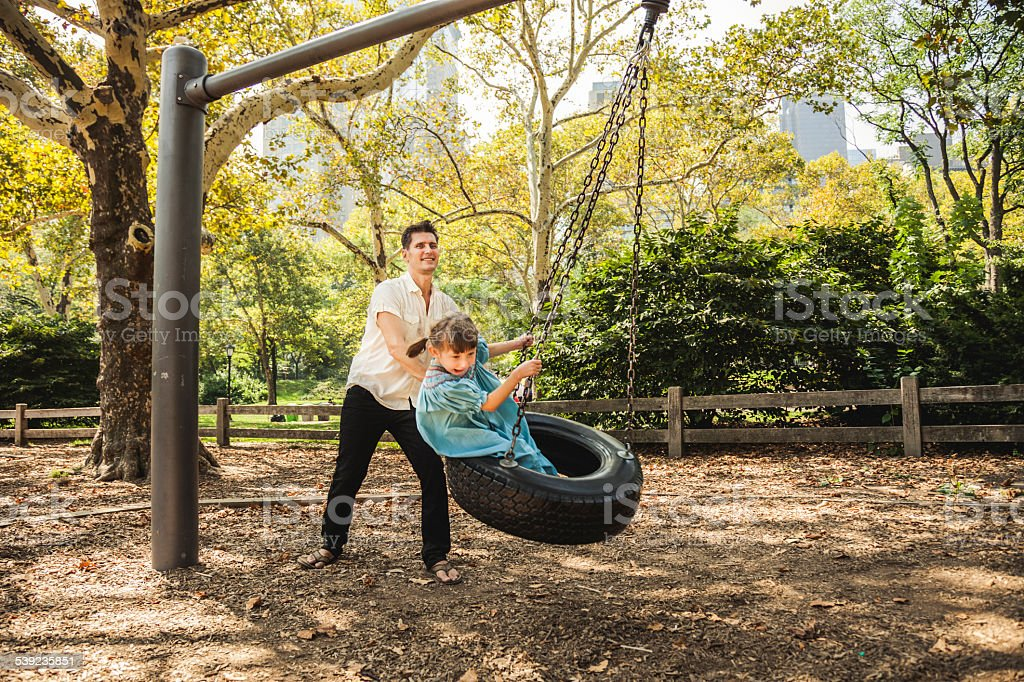 Happy young dad playing with his daughter royalty-free stock photo