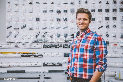 Portrait shot of a happiness smart confident young male owner businessman smiling and looking at camera in his shop small business owner concept