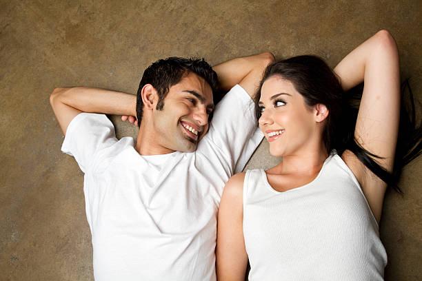 Happy young ethnic couple stock photo