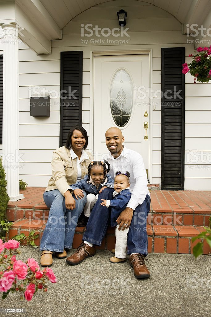 Happy Young Family at Home on Front Porch royalty-free stock photo
