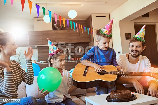 young family having fun celebrating birthday