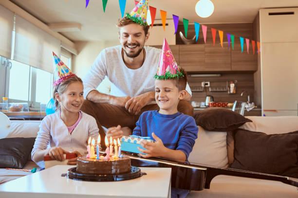 Happy Young Family Celebrating Birthday Stock Photo