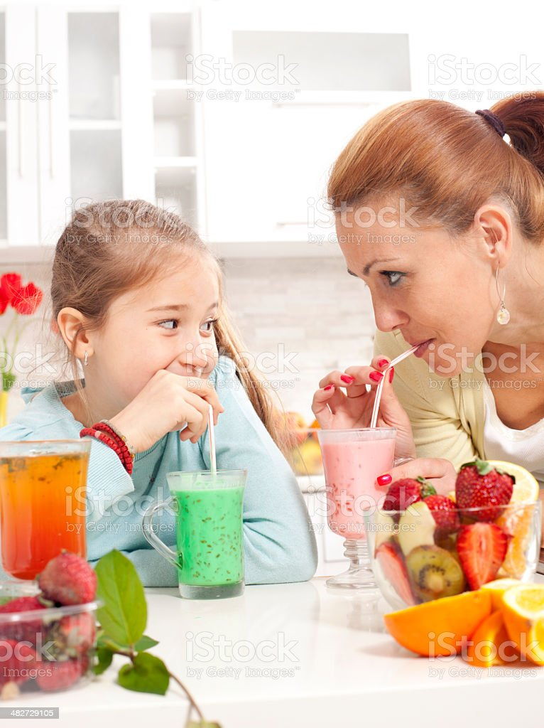 Happy young family drinking fresh  juice royalty-free stock photo