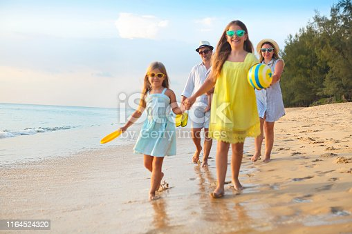 849648098 istock photo Happy young family have fun on beach 1164524320