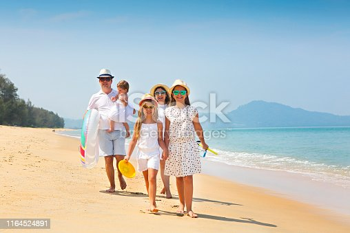 849648098 istock photo Happy young family have fun on beach 1164524891