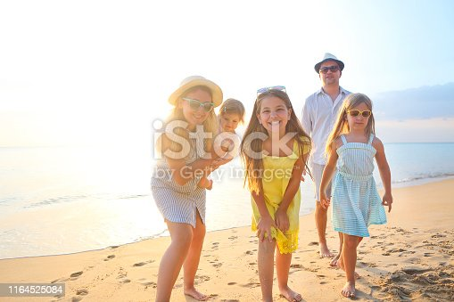 849648098 istock photo Happy young family have fun on beach 1164525084