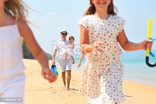 849648098 istock photo Happy young family have fun on beach 1164525124