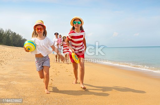 147878016 istock photo Happy young family have fun on beach 1164525502