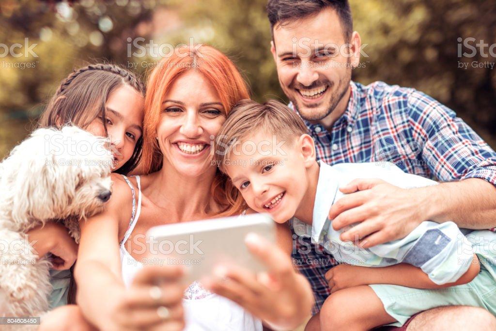 Happy young family having fun stock photo