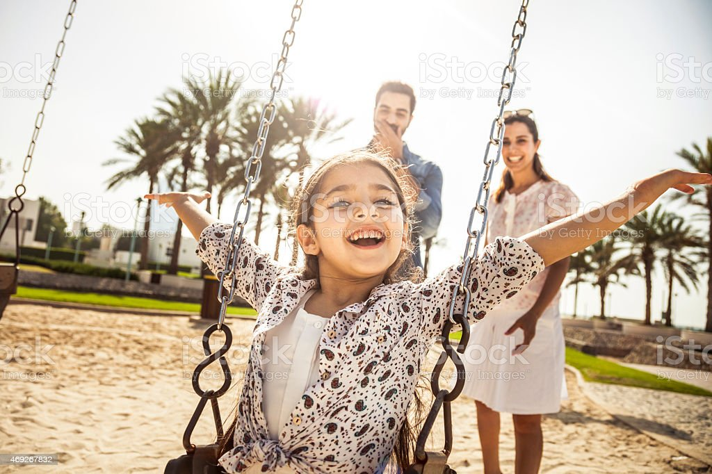 Happy young family in Dubai, UAE stock photo