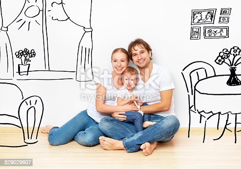 istock happy young family in  new apartment dream and plan interior 529029607