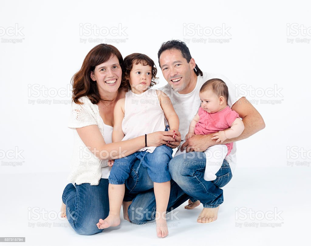 Happy young family isolated portrait stock photo