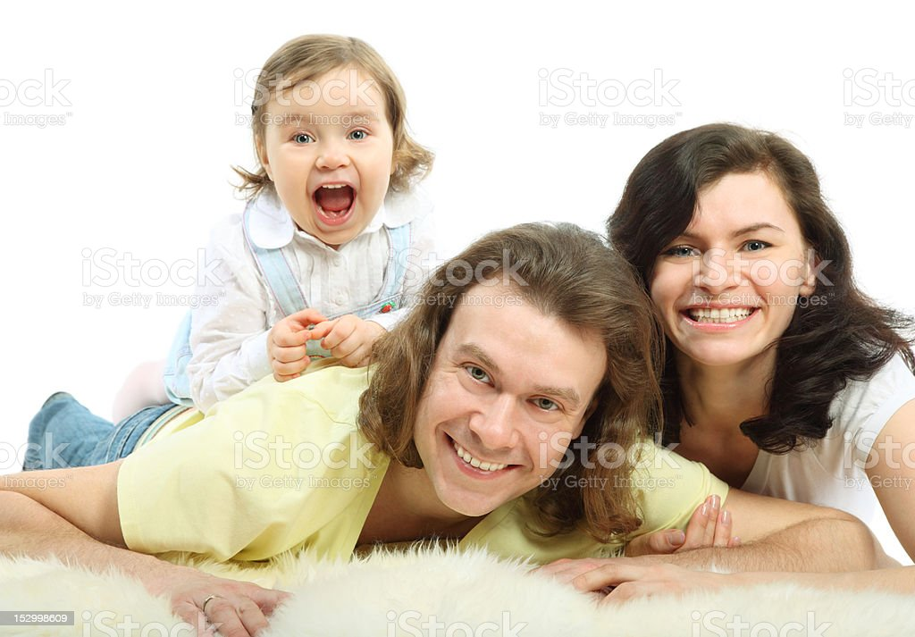 Happy young family lie on fluffy fur stock photo