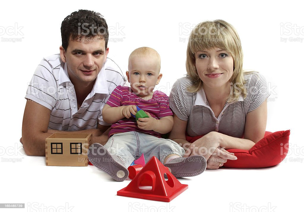 happy young family lying on the floor, studio isolated royalty-free stock photo