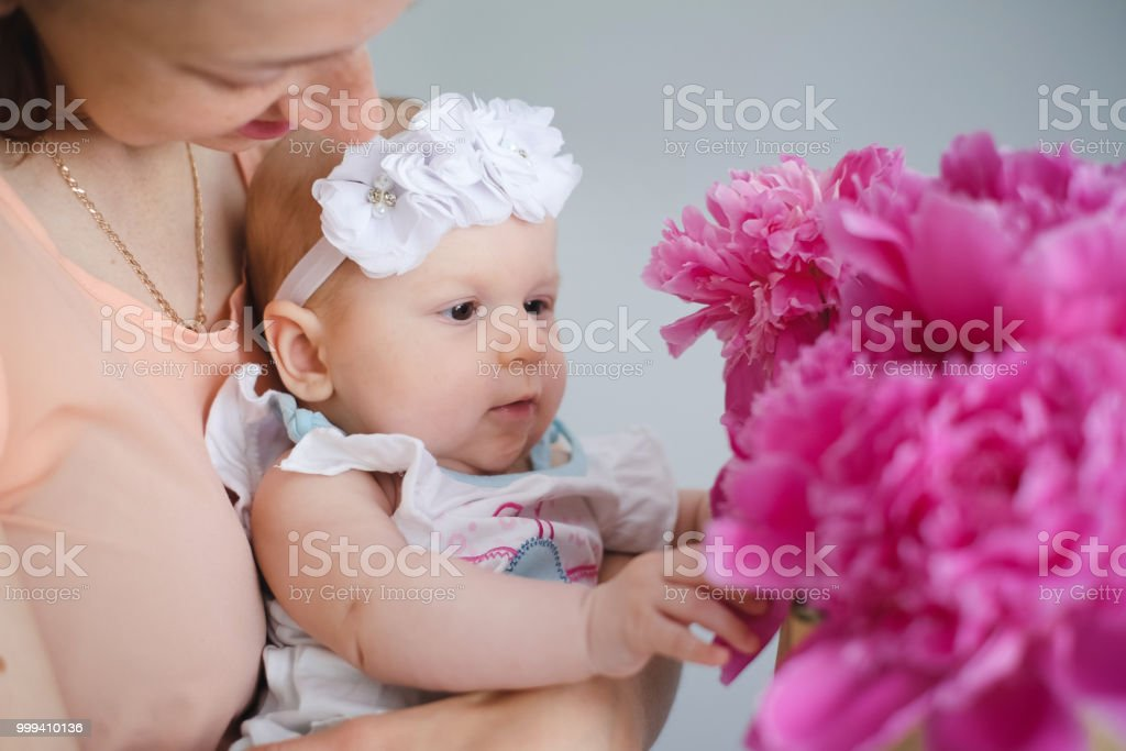 7745dad424 Happy Young Family Mom And Baby With Flowers Stock Photo   More ...