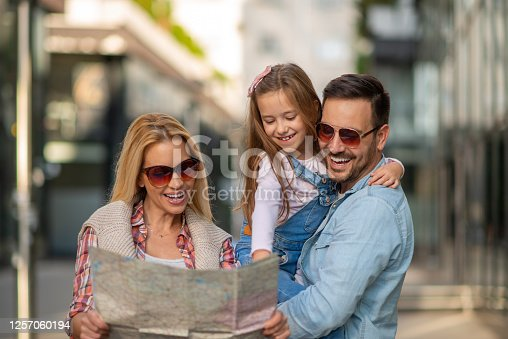 Happy young family of three smiling while spending time together.People,love,family and travel concept.Happiness and harmony concept.