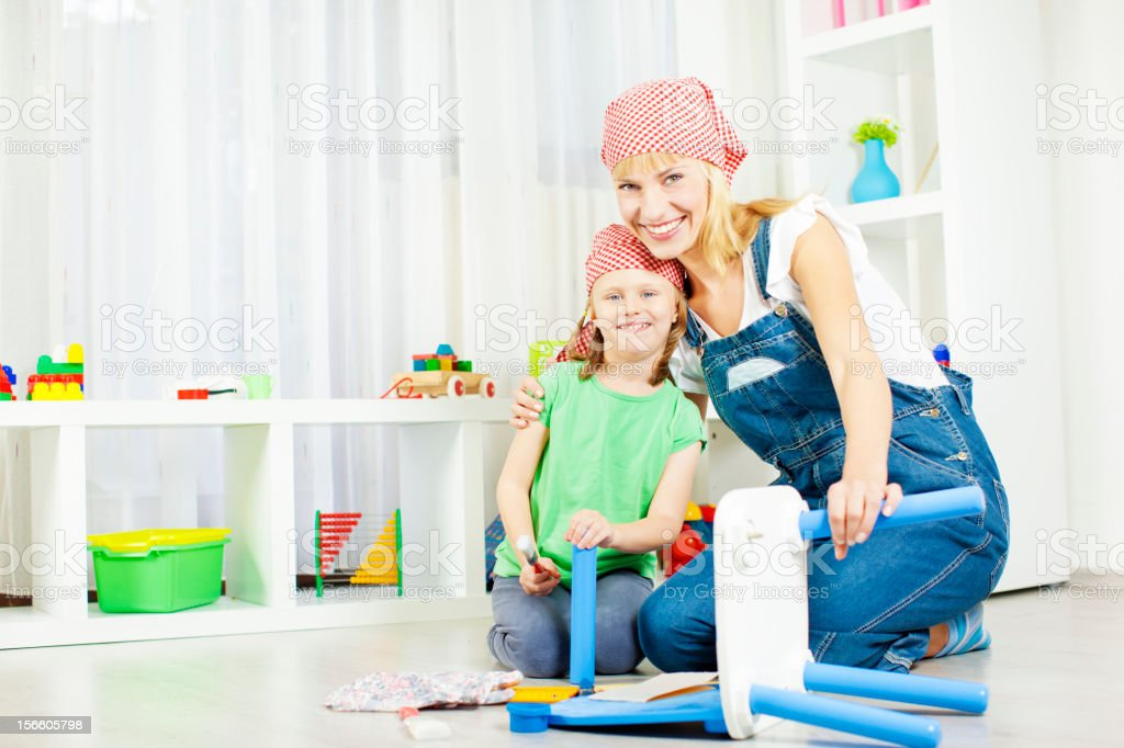 Happy Young Family Repair Furniture at home. royalty-free stock photo