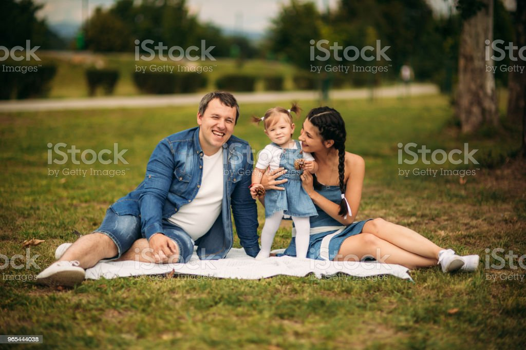 happy young family spending time outdoor on a summer day royalty-free stock photo