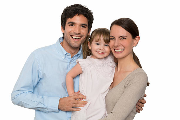 Happy  young Family standing on white background, isolated stock photo
