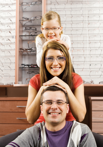 Happy Young Family Wearing New Glasses Stock Photo - Download Image Now