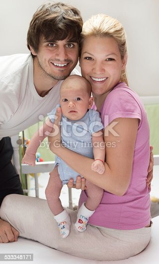 954356678 istock photo Happy young family with cute baby 533348171
