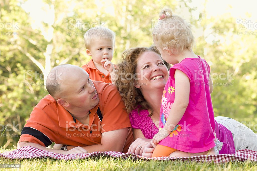Happy Young Family with Cute Twins in Park royalty-free stock photo