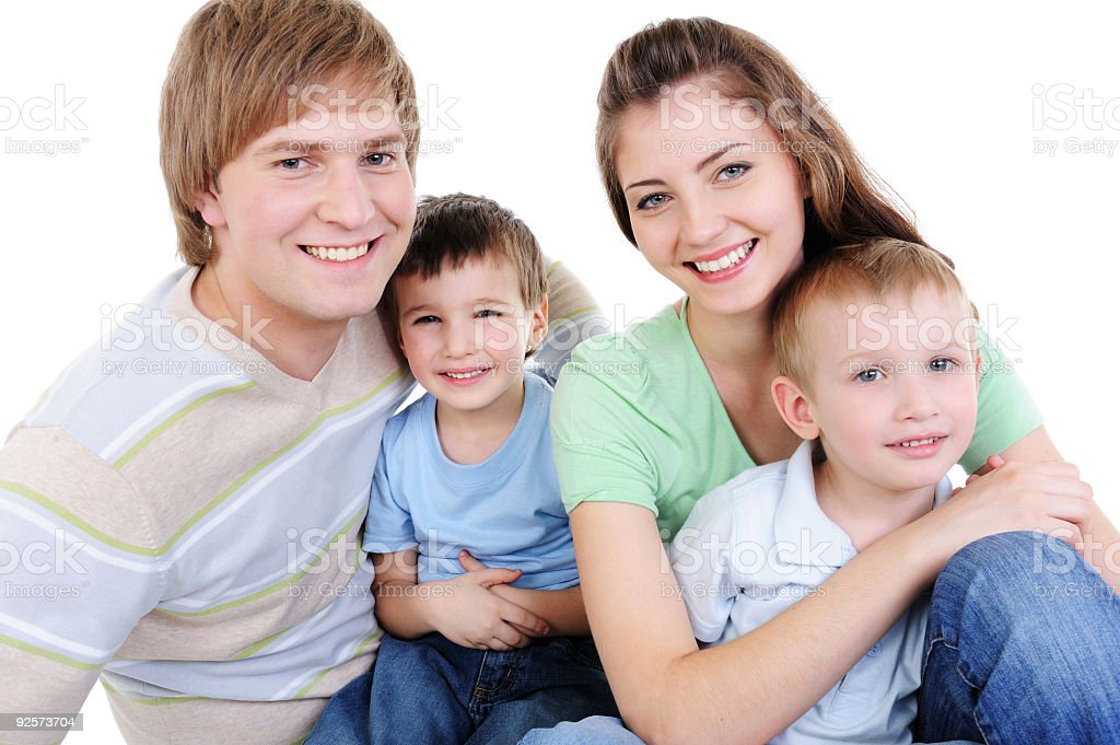 happy young family with two little sons royalty-free stock photo