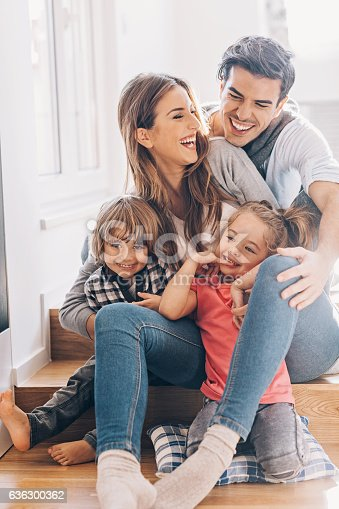 istock Happy young family with two small children 636300362