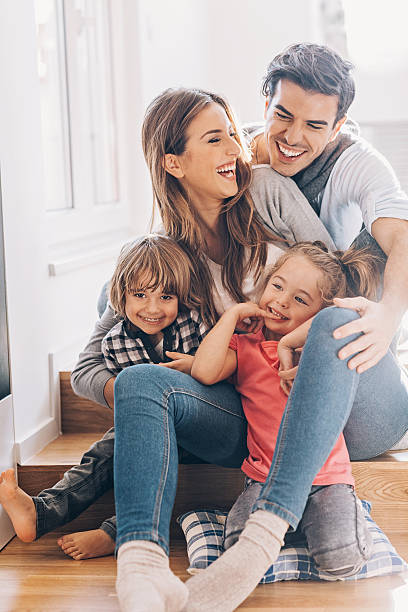 Happy young family with two small children stock photo