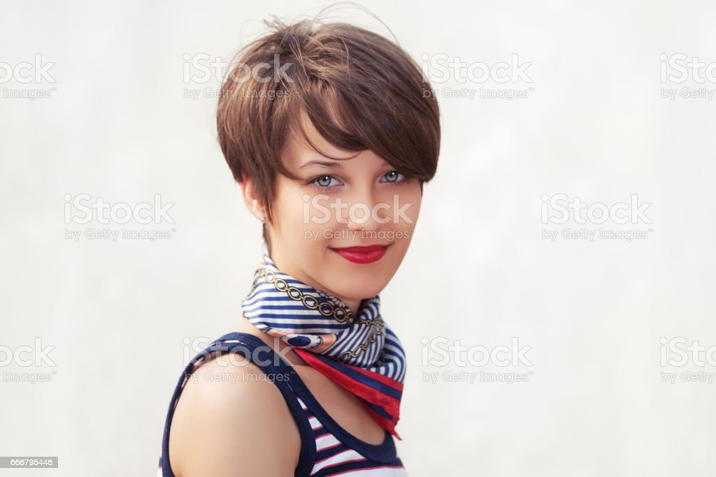 Happy young fashion woman walking outdoor stock photo