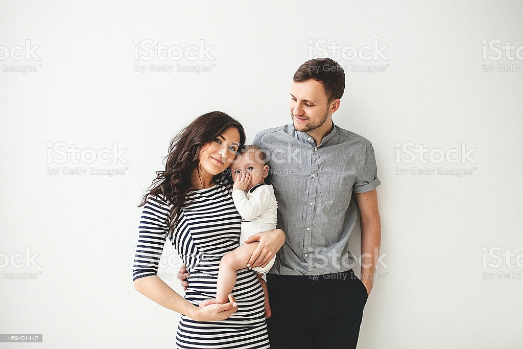 Happy young father mother and baby boy over white background stock photo