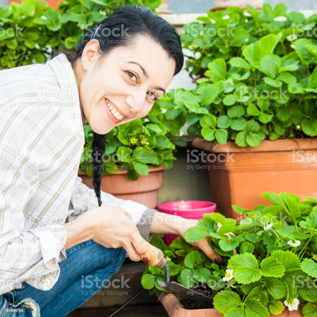 Happy young female gardener on his roof garden royalty-free stock photo