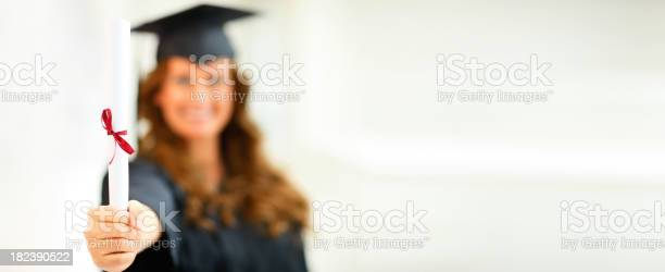 Happy Young Female Holding Degree Stock Photo - Download Image Now