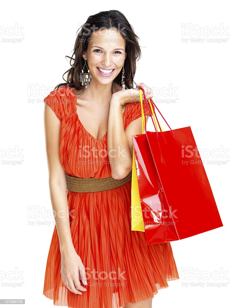 Happy young female holding shopping bags against white royalty-free stock photo