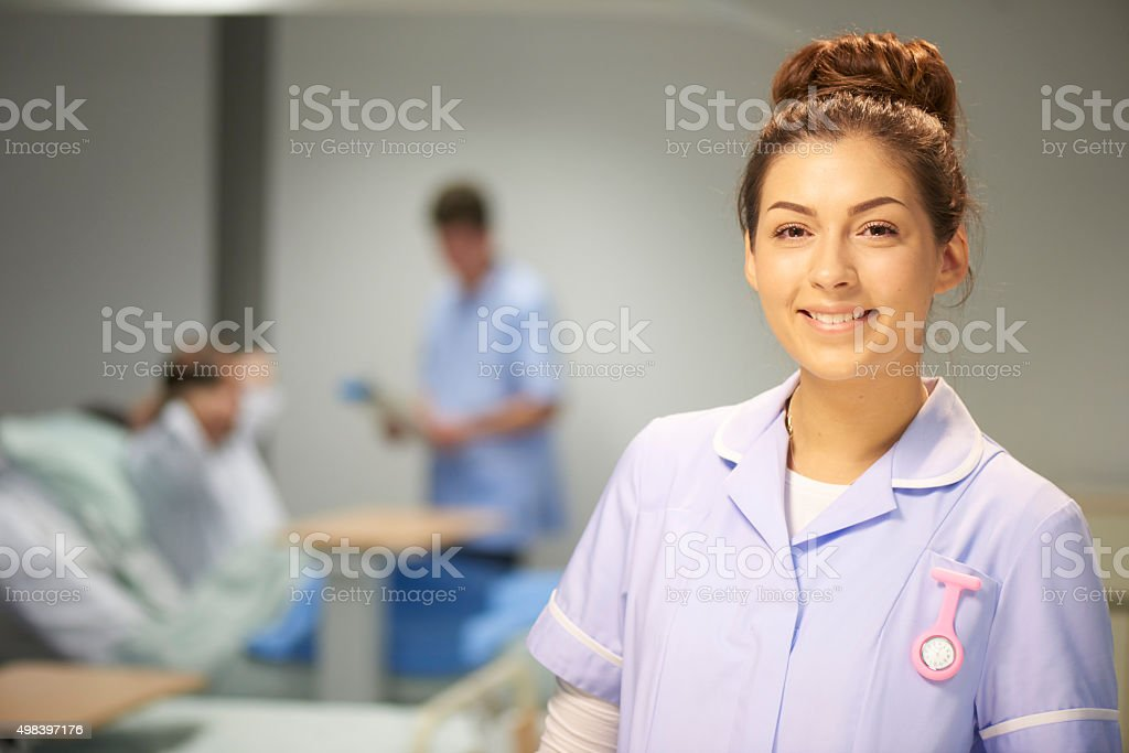 happy young female nurse stock photo