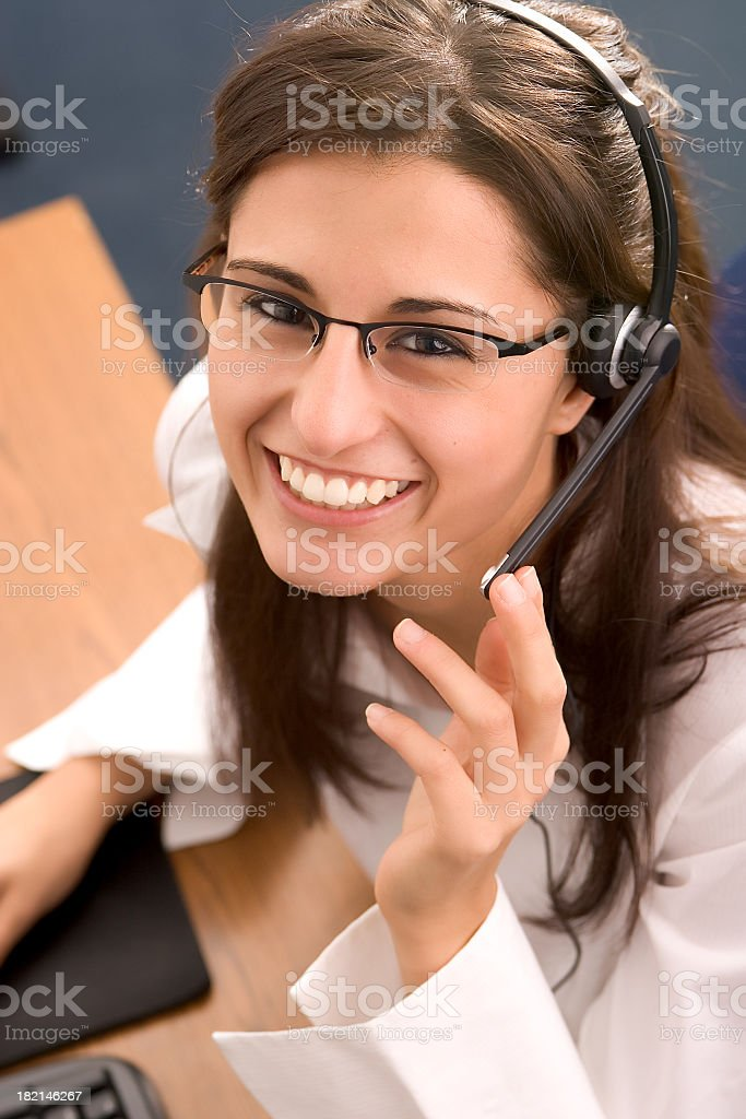 Happy young female phone operator royalty-free stock photo