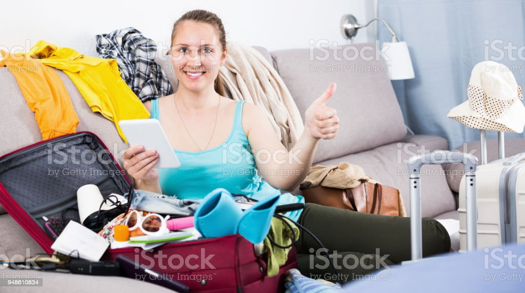 Happy young female ready to depart for holiday stock photo