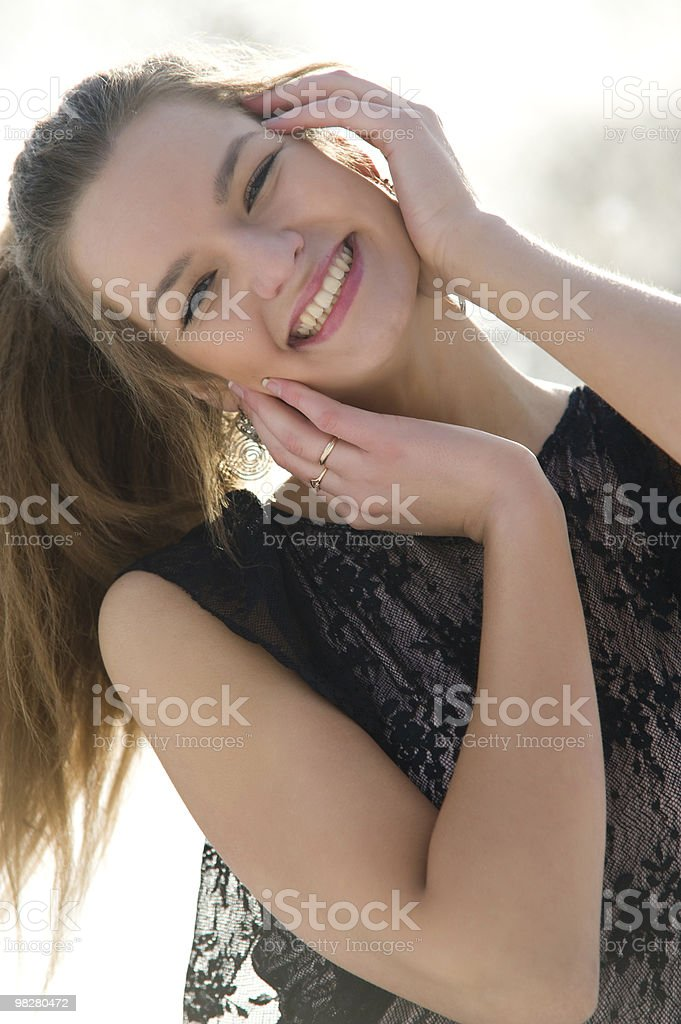 Happy young female smiling while outdoors royalty-free stock photo